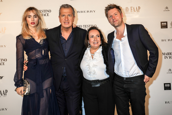 Suki Waterhouse, Mario Testino, Celita Procopio and Christopher Bailey at the Mario Testino `In Your Face' exhibition opening event in Brazil.